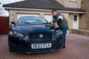 Mike Jones in driveway with his car vandalised with paint. CR0020521 Pic Kenny Smith, Kenny Smith Photography Tel 07809 450119