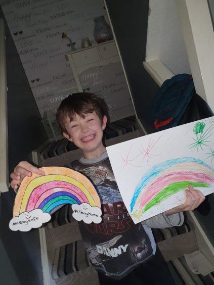 Danny, 6, from Douglas, is delighted with his drawings.