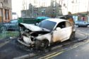 Crews were called after a car burst into flames. (Picture: Gareth Jennings/ DCT Media)