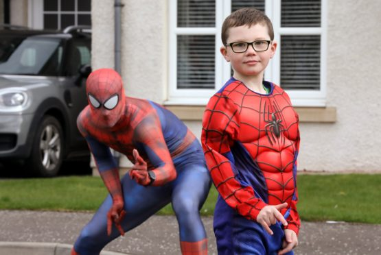 Olly Stuart, 7, came out to see Spider-Man.