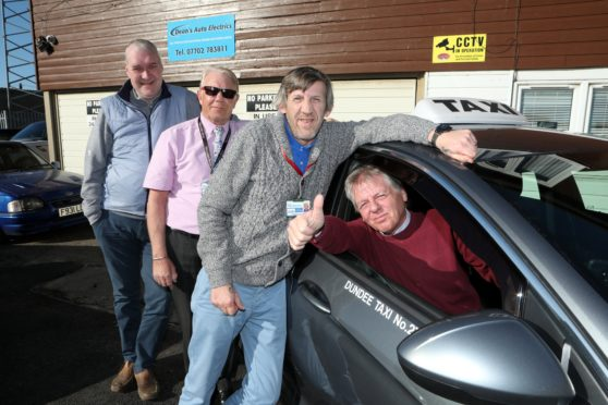 Tele Taxis are helping out the elderly by picking up prescriptions, shopping and other essentials. Pictured are drivers Eck Blackley (in car), Roland Mitchell, Rab Alexander and Alan Black.