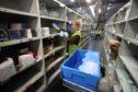 Amanda Thornton gathers supplies at the NHS' National Procurement Warehouse at Canderside, Larkhall.