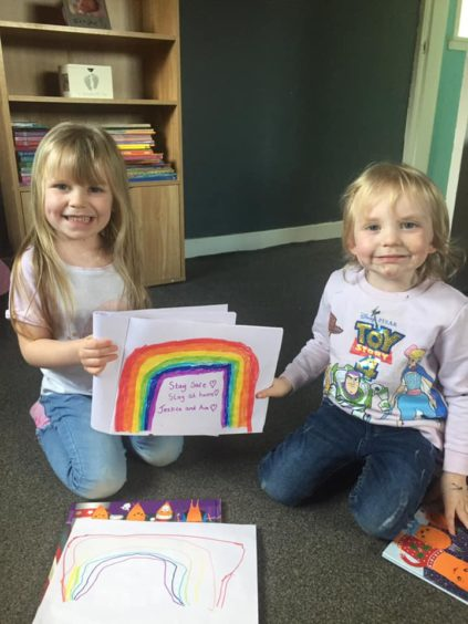 Jessica and Ava with their rainbow picture.
