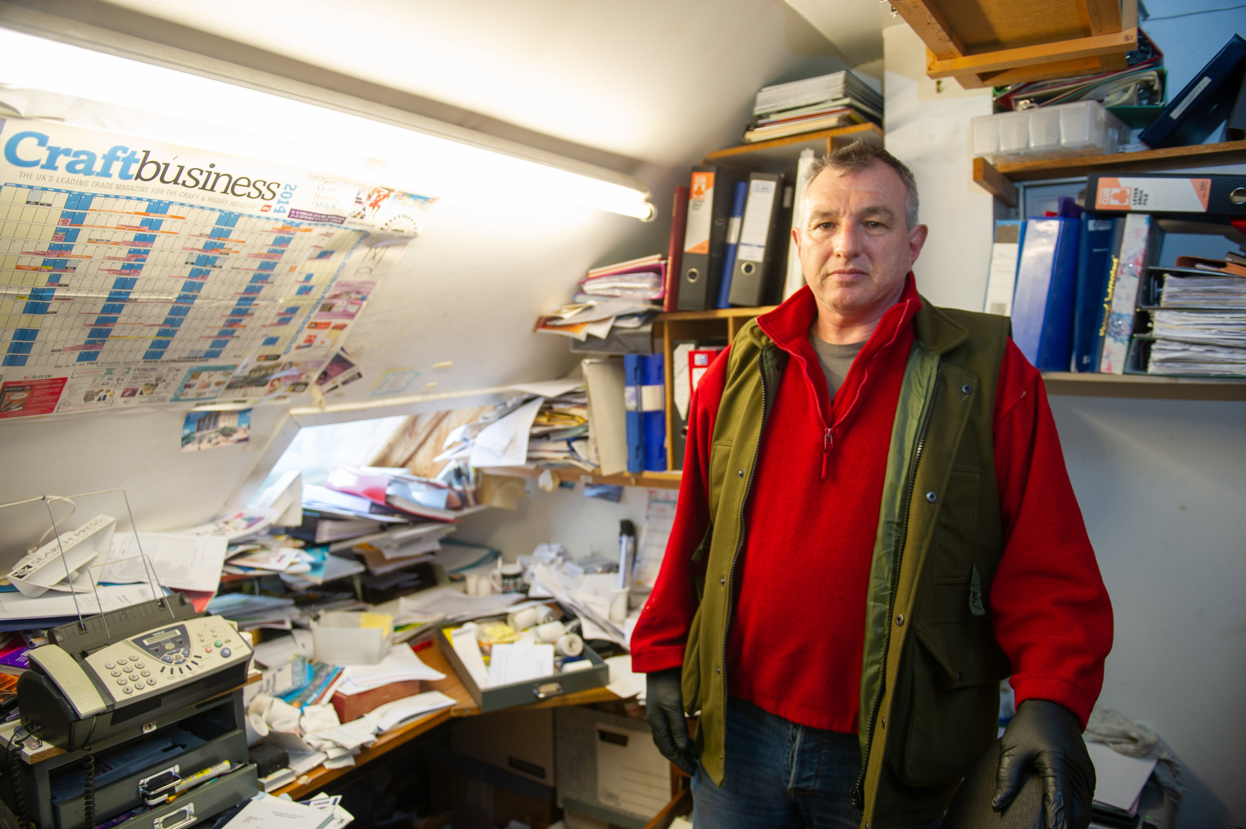Mr Sturrock at his parents' ransacked shop in Letham, Angus.