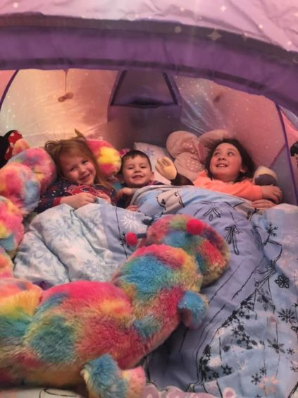 Kirsty Andrews sent a picture of her kids camping in the bedroom. Her family have been self-isolating for nine days but morale is still high!