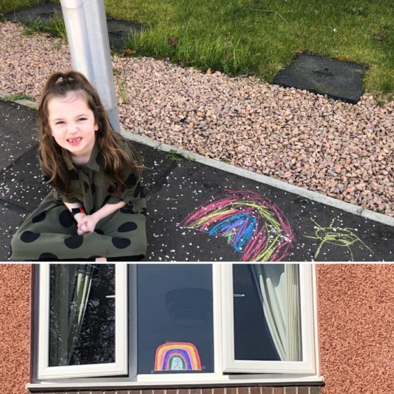 Billie, 7, with her colourful creations.