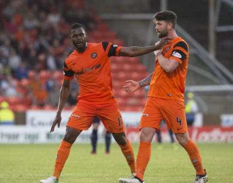 Ex-Dundee United man Wato Kuate clashes with Mark Durnan
