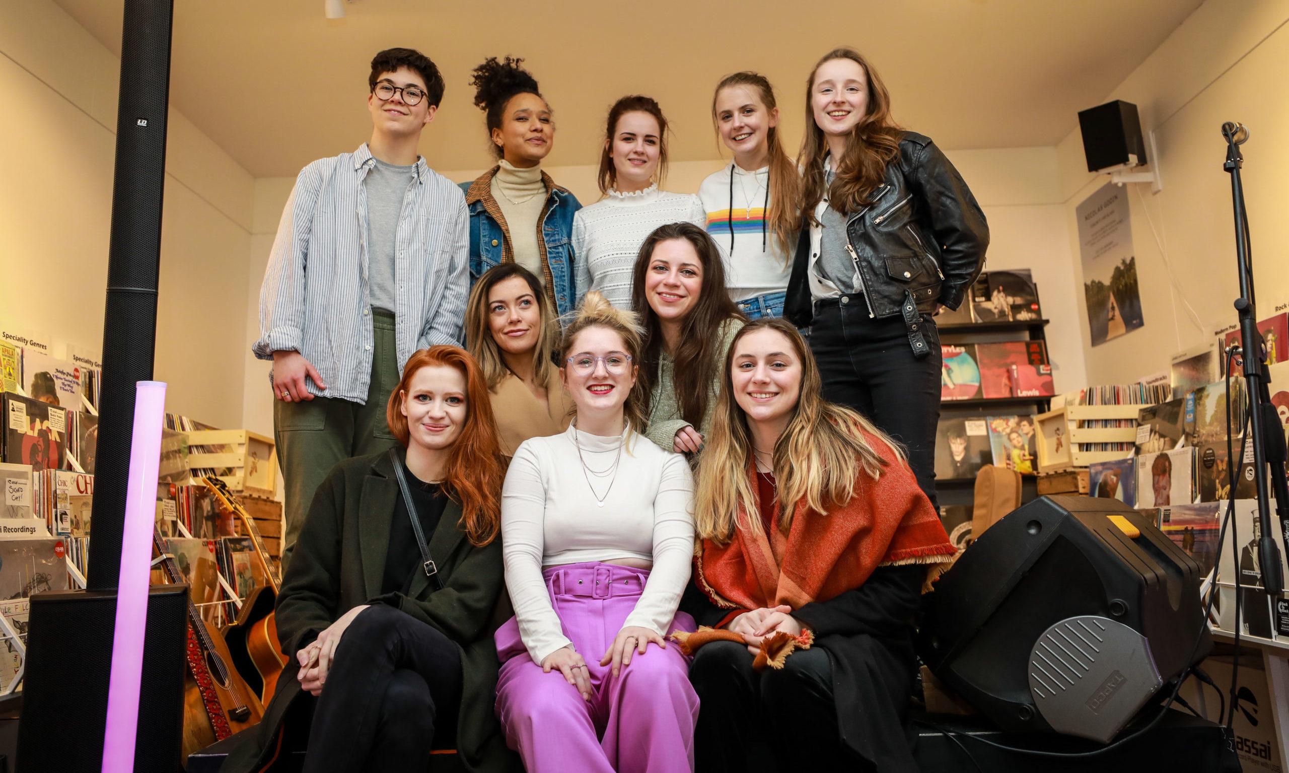 Be Charlotte (front, centre) with artists Megan Davidson, Becky Sikasa, Emily Atkinson, Rebecca Shearing, Zoe Graham, Stephanie Cheape, Anna Sweeney, Rachel Johnson and Liv Dawn.