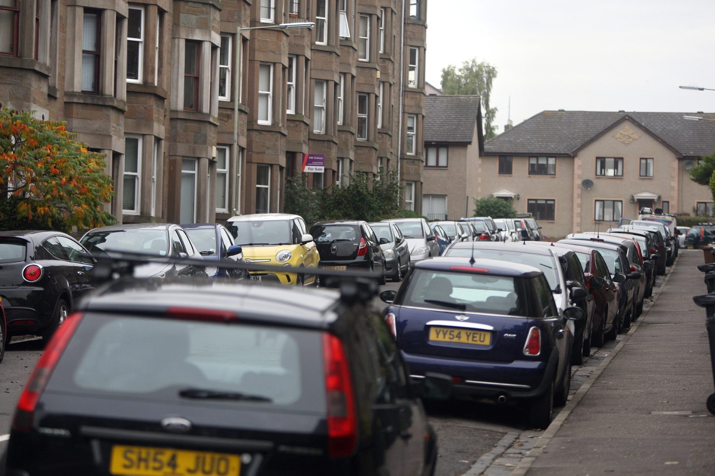 Parked cars in Dundee's Bellfield Avenue. (Stock image).