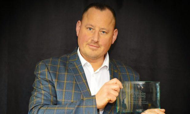 Ally Bongo with his award.