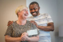Caryann McDermott and Anozie Awambu with the cheque.