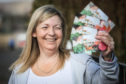 The Evening Telegraph, CR0020211, News, Sarah Williamson story, Nicola Saunders has won the £100 voucher Lidl Competition.  Picture shows; Nicola Saunders with her money vouchers. Thursday 5th March, 2020. Mhairi Edwards/DCT Media