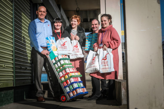 Unite members Bob Macgregor, Gillian Miller, Alice Bowman and Barclay McCrindle delivering donated goods to Lochee Larders Samantha Roberts.