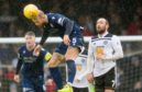 Jordon Forster clears this Ayr United attack.