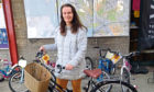 The first bike was given to Perth Care Worker Erin Tindal.