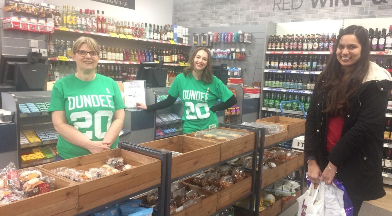 Moira Dean, Premier store manager and Lauren Macgregor, vice president of student welfare, are pictured with a student.