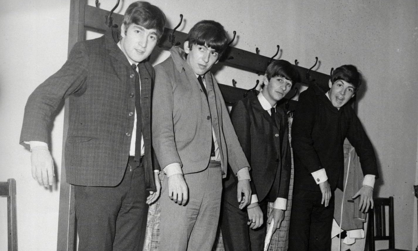 The Beatles hang out back stage at the Caird Hall.