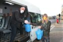 Alan Duncan & Jen McLean of the Grey Lodge Settlement collect food bags.