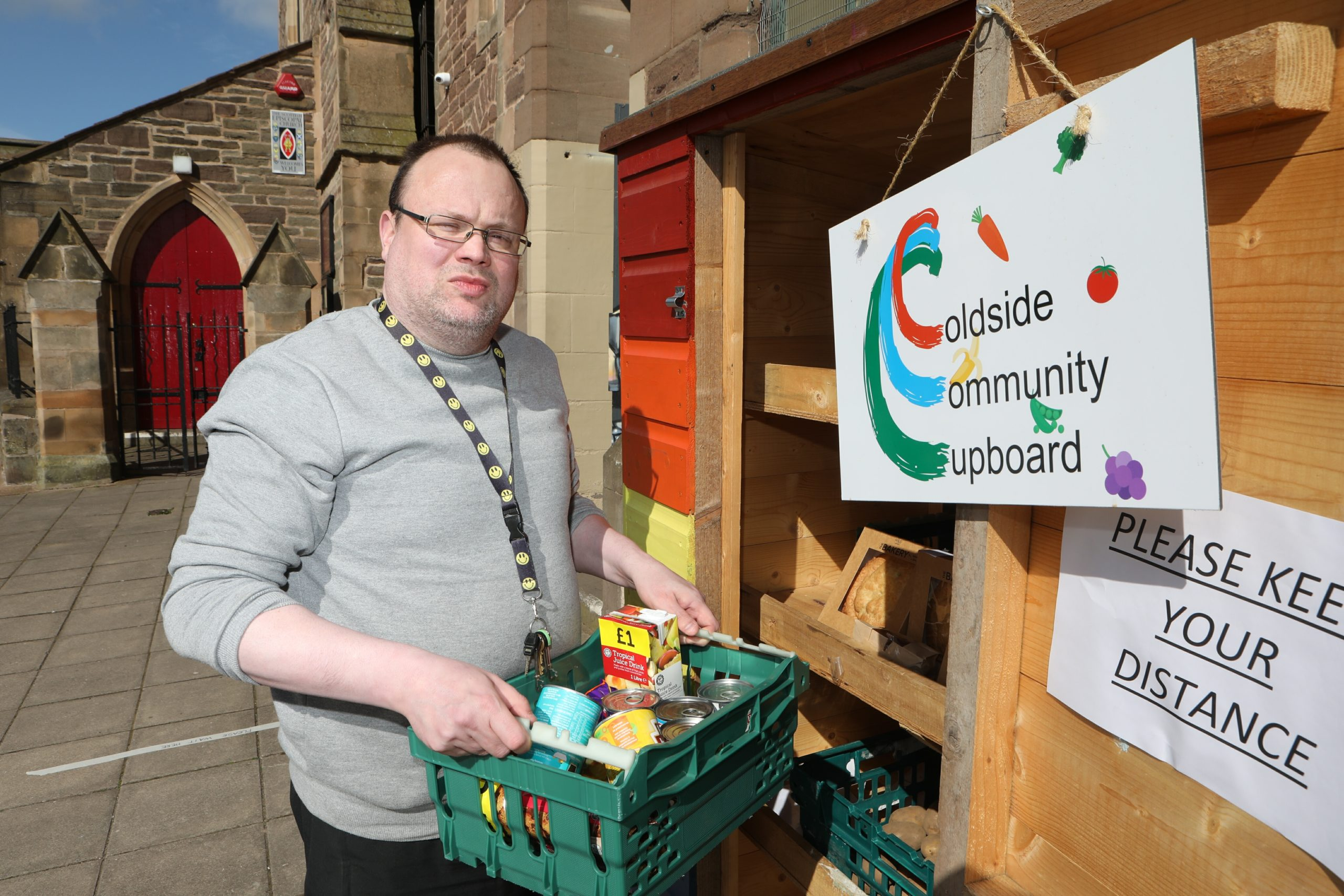 Andrew Kirk of the Maxwell Centre pictured at the outdoor food cupboard which is proving to be a great success (Picture: DCT Media/ Gareth Jennings)