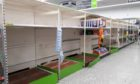 Bare shelves were seen in Asda's Milton store back in April when the first Covid-19 lockdown was announced.