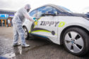 Sterilisation expert Stephen Roberts giving a Zippy D car a deep clean.