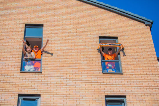 Dundee United fans celebrate the league win from the comfort of their own homes, during UK wide lockdown.