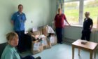 Staff from the Accute Admissions Ward at the Perth Royal Infirmary with some of the donations.