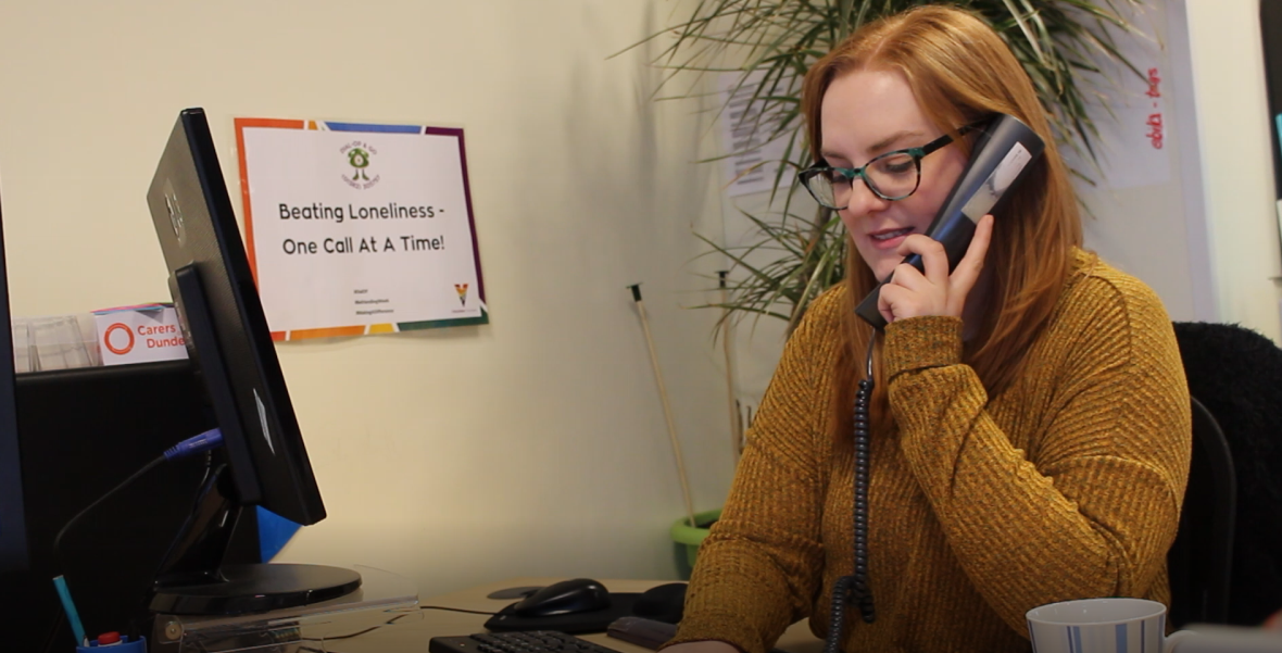 Sarah Samson takes calls on the Dial-OP line to arrange food deliveries