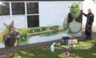 Rikki Craig has created the Shrek mural to reinforce the social distancing message.