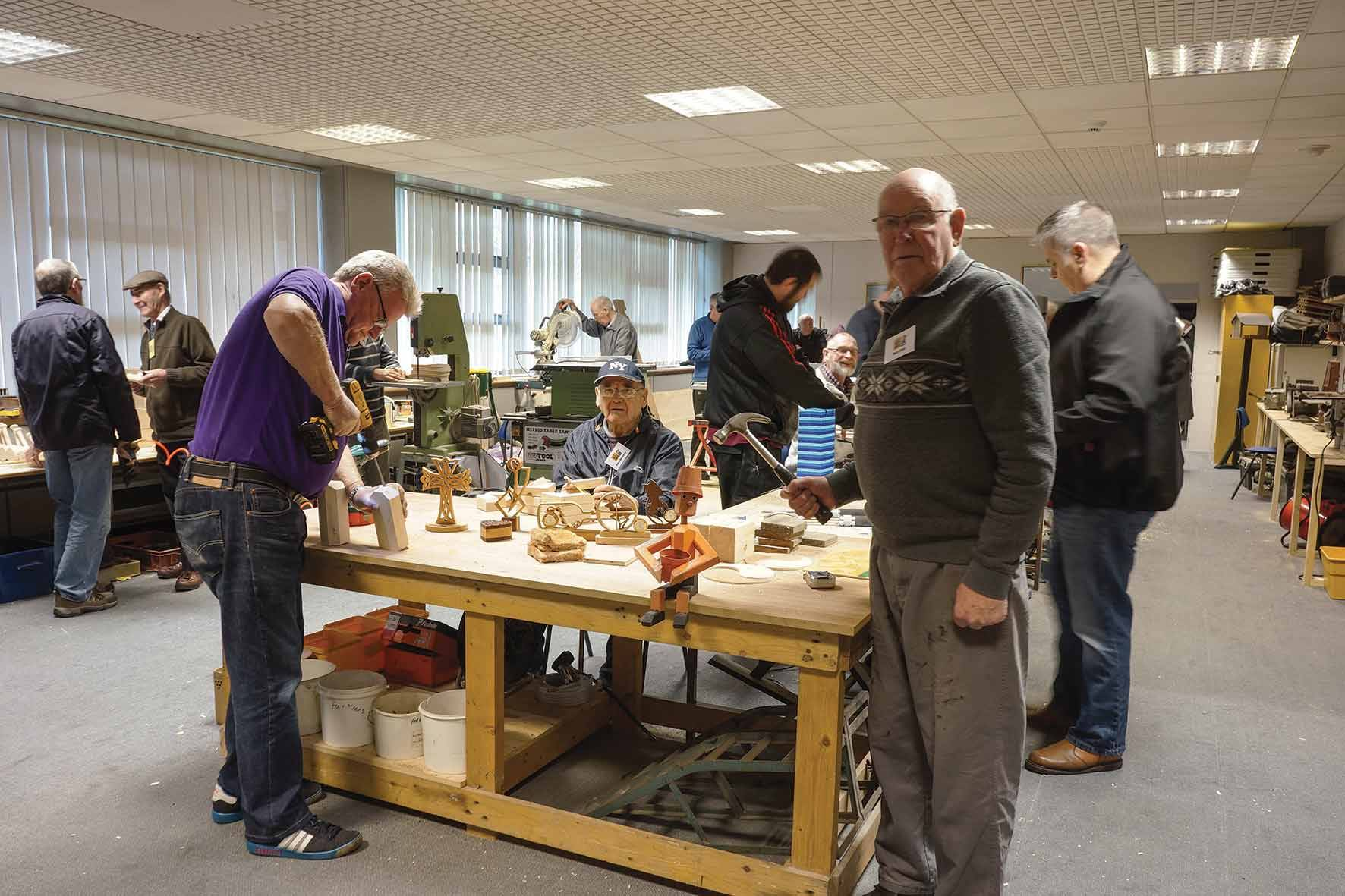 Members of the Carse Men's Shed during a woodworking workshop.
