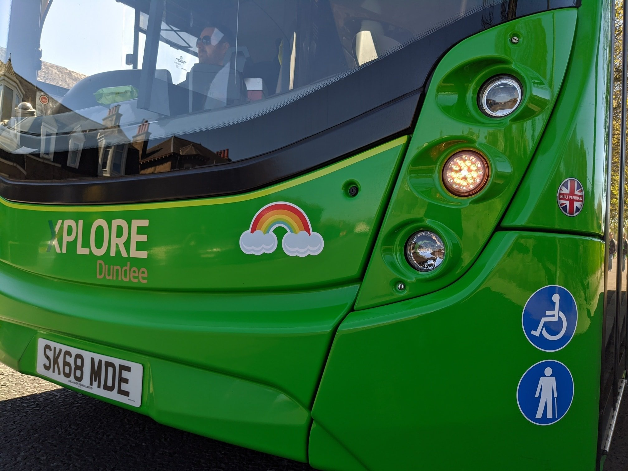 One of the rainbow stickers on an Xplore bus.