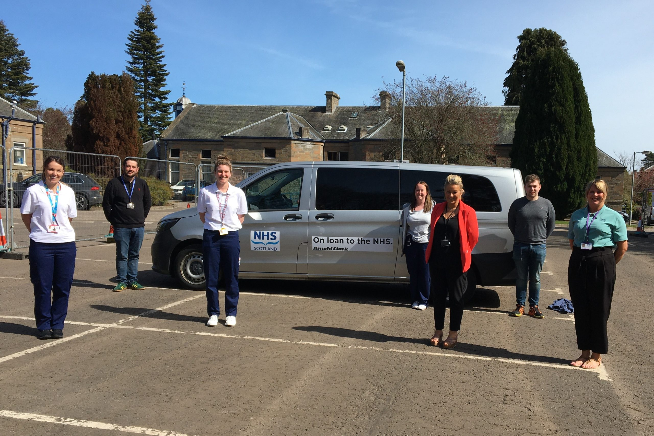 Staff from the transport hub with one of the donated vehicles.