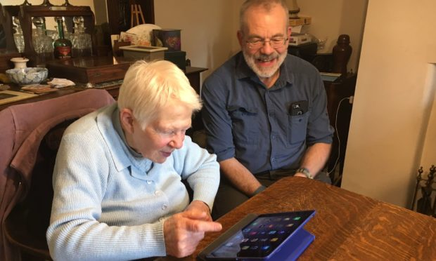 Andy, one of the volunteers for AbilityNet, with a client.