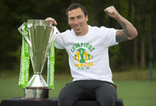 Scott Brown is pictured with the Ladbrokes Premiership trophy as Celtic are announced by the SPFL as title winners for the 2019/2020 season.