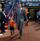 Lee Wilkie leads United out at Hampden, accompanied by Andy Webster's son, Kristian.
