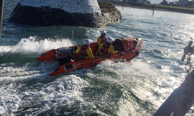 A small group of teens had been tombstoning near the Horseshoe cave when one found himself stuck, clinging to rocks, with an incoming tide.