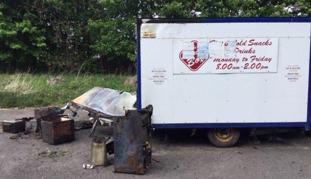 The wreckage of the burger van.