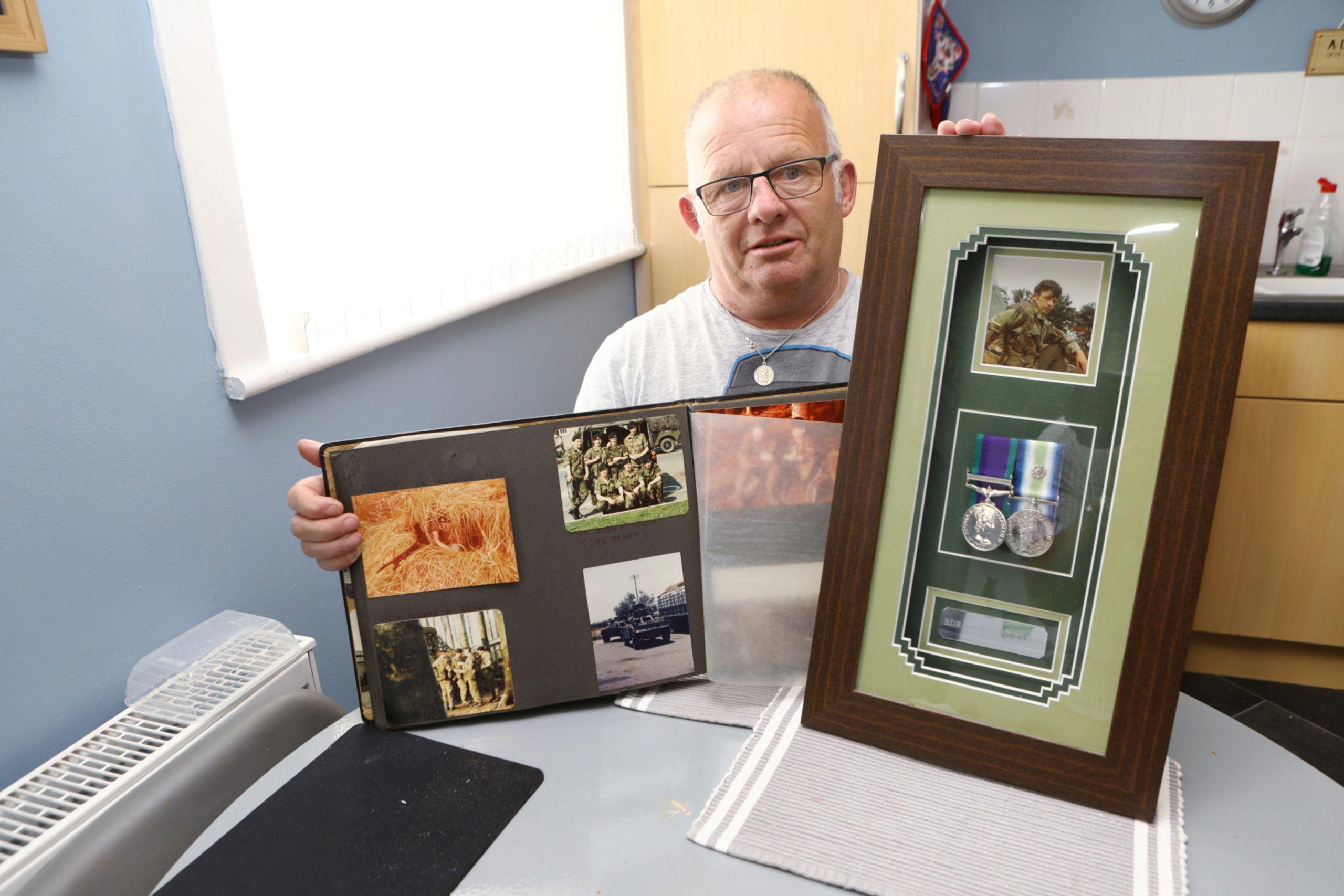 John Henderson, from Arbroath, has been reunited with a group of army buddies, he hasn't spoken to in 25 years. (Picture: Dougie Nicolson / DCT Media.)