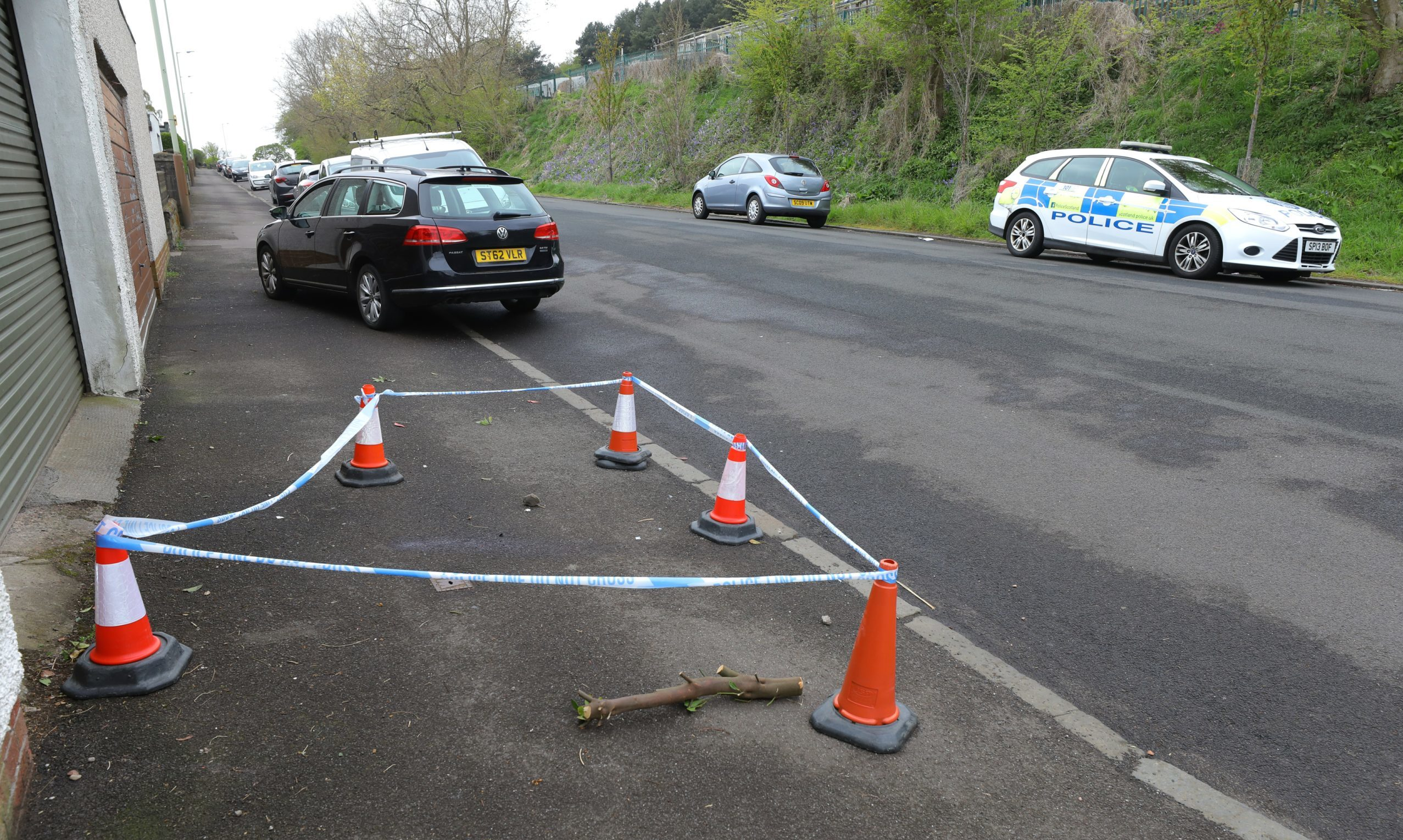 The scene at Kinghorne Road in Dundee, where a man collapsed prior to his death.