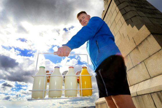 Connor Airlie has started his own business during lockdown called the Dundee Dairy Company, and is delivering free milk to houses with rainbows in the window and free dairy goods to key workers.