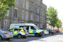 Police parked in Dundonald Street, where a number of drugs warrants were executed on Friday.