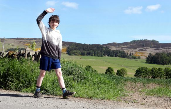 Charlie Watts, 9, from Auchterhouse is walking from Broughty Ferry Lifeboat station to the South Queensferry Lifeboat station to raise funds for the RNLI and in memory of his mum Eileen who died seven years ago. (Picture: Gareth Jennings/ DCT Media)