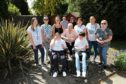 The Cornerstone carers who help to look after Elaine Thomson, 38, and Gemma Britten, 37, pictured with the pair and their parents Christine and Alex Thomson, and Karen Britten. (Picture: Gareth Jennings/ DCT Media)