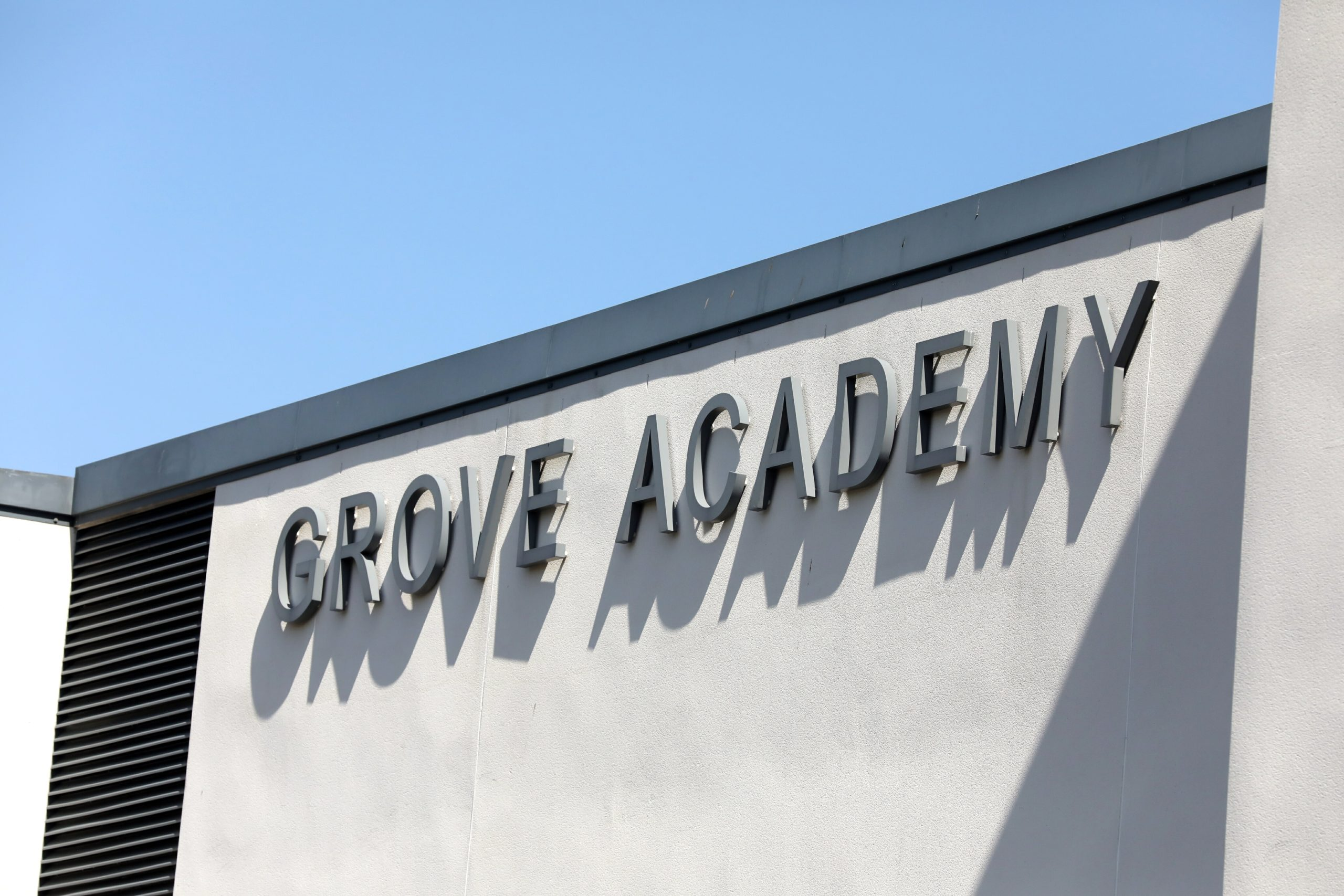 The opening of swimming and sports facilities at three schools, including Grove Academy, has been delayed.