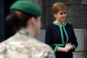Scotland's First Minister Nicola Sturgeon speaks to members of the armed forces outside St Andrew's House in Edinburgh.