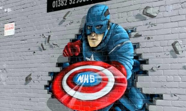 The completed design of Captain America etched with an NHS shield.