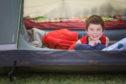 Benjamin Jones in his tent in the back garden.