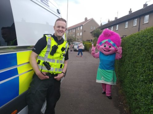 Sergeant Jamie Webster and a colourful character in Douglas, Dundee.