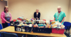 From left: medical secretaries Jane Aitken and Lorna Robertson, and support worker John Coyle, with the foodbank donations.