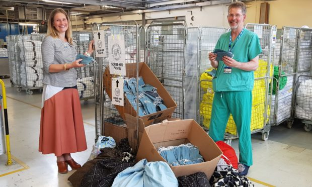 Consultant surgeon Rodney Mountain received the face coverings from Jane Keith of Duncan of Jordanstone College of Art and Design Textiles Department